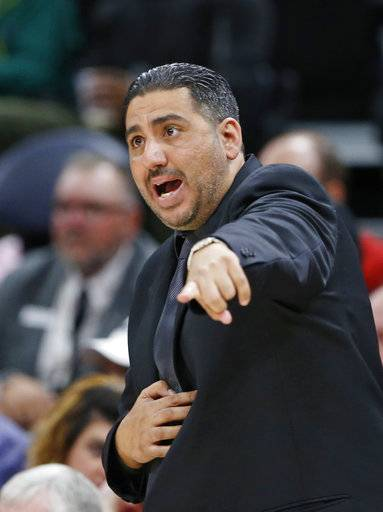 Maccabi Haifa head coach Offer Rahimi shouts to his team during the first half of a preseason NBA basketball game against the Utah Jazz Wednesday, Oct. 4, 2017, in Salt Lake City.