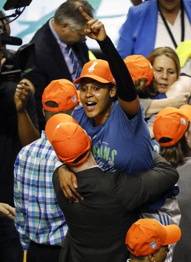 Minnesota Lynx forward Maya Moore (23) celebrates with other Lynx players and staff after winning the WNBA finals against the L.A. Sparks at Williams Arena, Wednesday, Oct. 4, 2017 in Minneapolis. (Renee Jones Schneider/Star Tribune via AP)