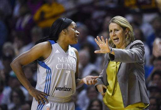 Minnesota Lynx coach Cheryl Reeve speaks with guard Jia Perkins (7) during Game 5 against the Los Angeles Sparks in the WNBA basketball finals, Wednesday, Oct. 4, 2017, in Minneapolis. (Aaron Lavinsky/Star Tribune via AP)