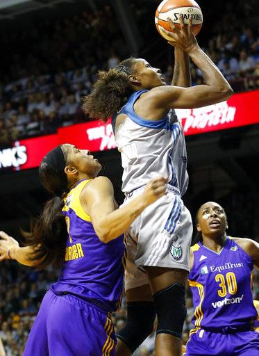 Minnesota Lynx's Rebekkah Brunson, right, jumps high above Los Angeles Sparks' Candace Parker as she shoots in the first half during Game 5 of the WNBA Finals Wednesday, Oct. 4, 2017, in Minneapolis.