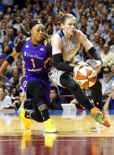 Los Angeles Sparks' Odyssey Sims, left, reaches in to knock the ball away from Minnesota Lynx's Lindsay Whalen in the first half during Game 5 of the WNBA Finals Wednesday, Oct. 4, 2017, in Minneapolis.
