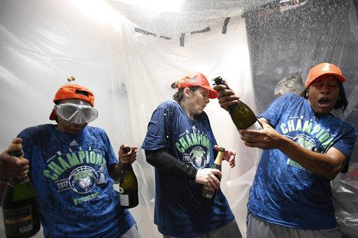 From left, Minnesota Lynx guard Renee Montgomery (21), guard Lindsay Whalen (13) and guard Jia Perkins (7) celebrate after winning the WNBA finals against the Los Angeles Sparks, Wednesday, Oct. 4, 2017 in Minneapolis. The Minnesota Lynx won their fourth championship in seven years with an 85-76 victory over the Los Angeles Sparks in Game 5 on Wednesday. (Aaron Lavinsky/Star Tribune via AP)