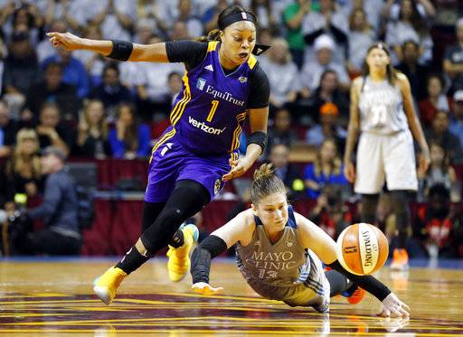 Minnesota Lynx's Lindsay Whalen, right, loses the ball as she falls with Los Angeles Sparks' Odyssey Sims giving chase in the second half during Game 5 of the WNBA Finals Wednesday, Oct. 4, 2017, in Minneapolis. The Lynx won the WNBA Championship with their 85-76 win. Whalen scored 17 points.