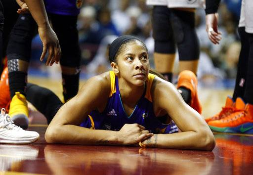 Los Angeles Sparks' Candace Parker looks up fro the floor after being fouled by a Minnesota Lynx player in the second half during Game 5 of the WNBA Finals Wednesday, Oct. 4, 2017, in Minneapolis. The Lynx won the WNBA Championship with their 85-76 victory. Parker led the Sparks with 19 points.