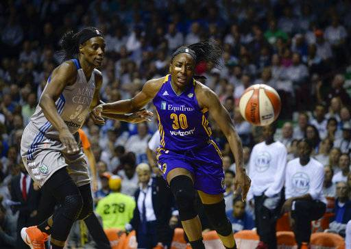 Minnesota Lynx center Sylvia Fowles and Los Angeles Sparks forward Nneka Ogwumike chase a loose ball during the first half of Game 5 of the WNBA Finals, Wednesday, Oct. 4, 2017 in Minneapolis. (Aaron Lavinsky/Star Tribune via AP)