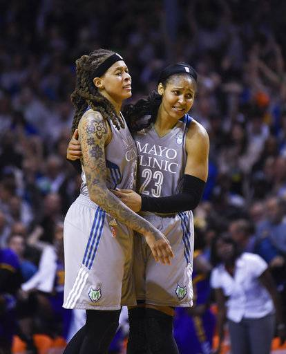 Minnesota Lynx guard Seimone Augustus (33) and forward Maya Moore (23) embrace after Game 5 of the WNBA Finals against the Los Angeles Sparks, Wednesday, Oct. 4, 2017 in Minneapolis. The Minnesota Lynx won their fourth championship in seven years with an 85-76 victory over the Los Angeles Sparks in Game 5 on Wednesday. (Aaron Lavinsky/Star Tribune via AP)