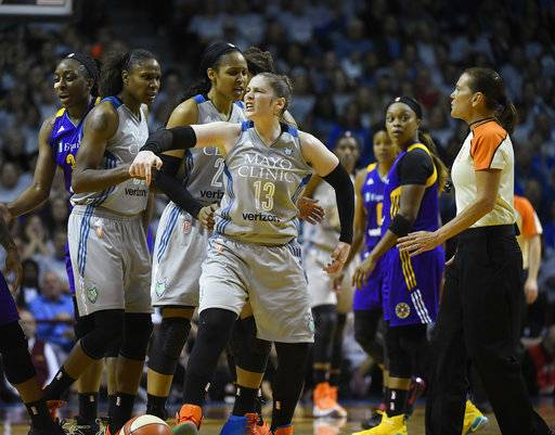 Minnesota Lynx guard Lindsay Whalen reacts to being fouled by Los Angeles Sparks guard Riquna Williams (2) during the first half of Game 5 of the WNBA Finals, Wednesday, Oct. 4, 2017 in Minneapolis. (Aaron Lavinsky/Star Tribune via AP)