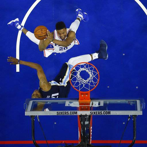Philadelphia 76ers' Markelle Fultz, top, goes up for a shot against Memphis Grizzlies' Deyonta Davis during the first half of a preseason NBA basketball game, Wednesday, Oct. 4, 2017, in Philadelphia.