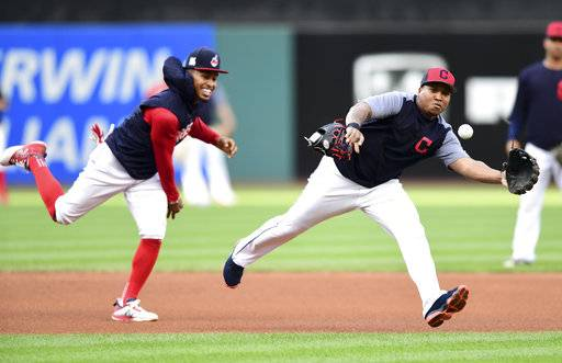 Cleveland Indians' Jose Ramirez, right, fields a ball chased by Francisco Lindor during a team workout, Wednesday, Oct. 4, 2017, in Cleveland. The Indians will play the New York Yankees in Game 1 of the ALDS on Thursday.
