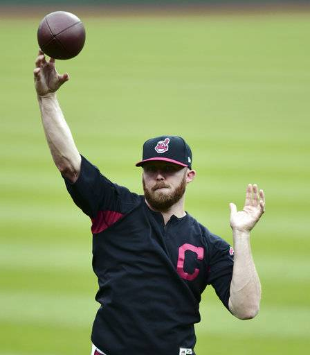 Cleveland Indians relief pitcher Cody Allen throws a football during a team workout, Wednesday, Oct. 4, 2017, in Cleveland. The Indians will play the New York Yankees in Game 1 of the ALDS on Thursday.