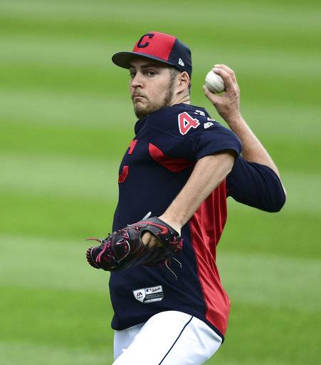 Cleveland Indians pitcher Trevor Bauer throws during a team workout, Wednesday, Oct. 4, 2017, in Cleveland. The Indians are scheduled to play the New York Yankees in Game 1 of an ALDS on Thursday.