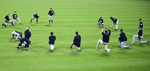 The New York Yankees stretch during a team workout Wednesday, Oct. 4, 2017, in Cleveland. The Yankees are scheduled to play the Cleveland Indians in Game 1 of am ALDS on Thursday.