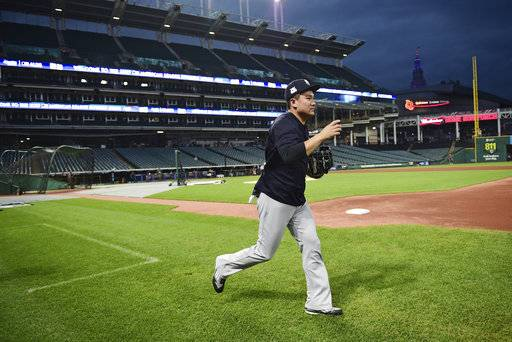 New York Yankees starting pitcher Masahiro Tanaka runs out onyp the field during a team workout, Wednesday, Oct. 4, 2017, in Cleveland. The Yankees are scheduled to play the Cleveland Indians in Game 1 of an ALDS on Thursday.