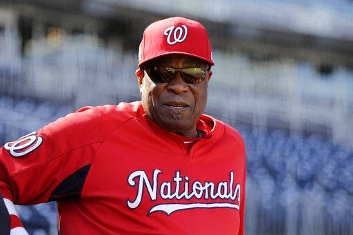 Washington Nationals manager Dusty Baker watches the team during baseball practice at Nationals Park, Wednesday, Oct. 4, 2017, in Washington. Game 1 of the National League Division Series against the Chicago Cubs is Friday.