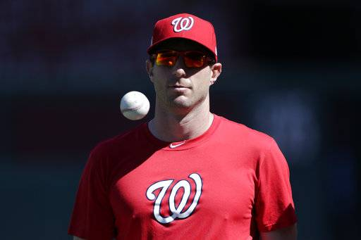 Washington Nationals' pitcher Max Scherzer walks to the dugout during a baseball workout at Nationals Park, Wednesday, Oct. 4, 2017, in Washington. The Nationals host the Chicago Cubs in Game 1 of the National League Division Series on Friday.