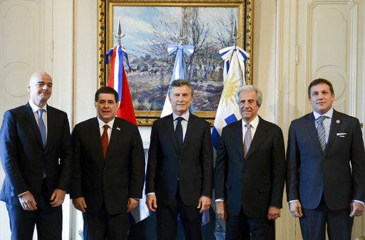 In this photo provided by Argentina's Presidency, FIFA President Gianni Infantino, left, Paraguay's President Horacio Cartes, second left, Argentina's President Mauricio Macri, center, Uruguay's President Tavare Vazquez, second right, and CONMEBOL President Alejandro Dominguez pose for a photo at Casa Rosada in Buenos Aires, Argentina, Wednesday, Oct. 4, 2017. Argentina, Paraguay and Uruguay say they plan to make a three-nation bid to host soccer's centenary World Cup in 2030. (Argentine Presidency via AP)