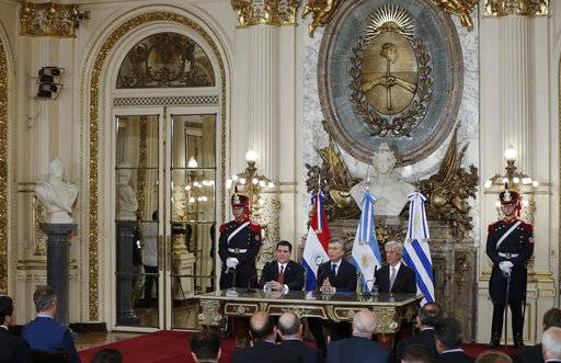 Horacio Cartes, President of Paraguay, Argentina's President Mauricio Macri and Uruguay's President Tabare Vazquez, from left to right, attend a press conference at the government house after a meeting in Buenos Aires, Argentina, Wednesday, Oct. 4, 2017. Argentina, Paraguay and Uruguay say they plan to make a three-nation bid to host soccer's centenary World Cup in 2030.