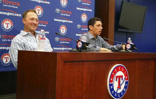 Texas Rangers manager Jeff Banister, left, smiles as general manager Jon Daniels speaks during an end of season media availability in Arlington,Texas, Wednesday, Oct. 4, 2017. The Rangers announced they have exercised the 2019 option on the contract of Banister.