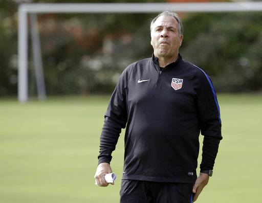 United States head coach Bruce Arena watches players go through drills during a soccer training session, Monday, Oct. 2, 2017, in Sanford, Fla. The United States hosts Panama in a World Cup qualifying match on Friday, Oct. 6.