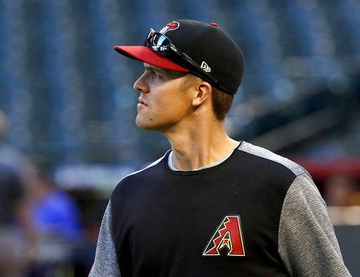 Arizona Diamondbacks starting pitcher Zack Greinke takes the field during a workout at Chase Field, Tuesday, Oct. 3, 2017, in Phoenix, as the team gets ready for a National League wild-card playoff baseball game. The Diamondbacks host the Colorado Rockies on Wednesday.