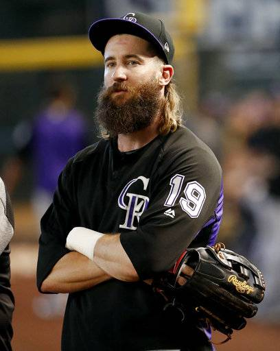 Colorado Rockies center fielder Charlie Blackmon watches during practice for Wednesday's National League wild-card playoff baseball game against the Arizona Diamondbacks, Tuesday, Oct. 3, 2017, in Phoenix.