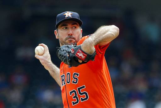 FILE - In this Sept. 27, 2017, file photo, Houston Astros starting pitcher Justin Verlander winds up to throw to the Texas Rangers during a baseball game in Arlington, Texas. The Astros will start Verlander in Game 1 of the AL Division Series against Chris Sale and the Boston Red Sox on Thursday, Oct 5. Manager A.J. Hinch announced the decision Tuesday, adding that left-hander Dallas Keuchel, who won the AL Cy Young Award in 2015, will start Game 2 on Friday against Drew Pomeranz.