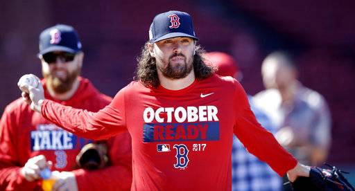 Boston Red Sox relief pitcher Heath Hembree stretches out as he heads to the outfield during baseball practice at Fenway Park in Boston, Tuesday, Oct. 3, 2017. The Red Sox face the Houston Astros in the American League Division playoff series.