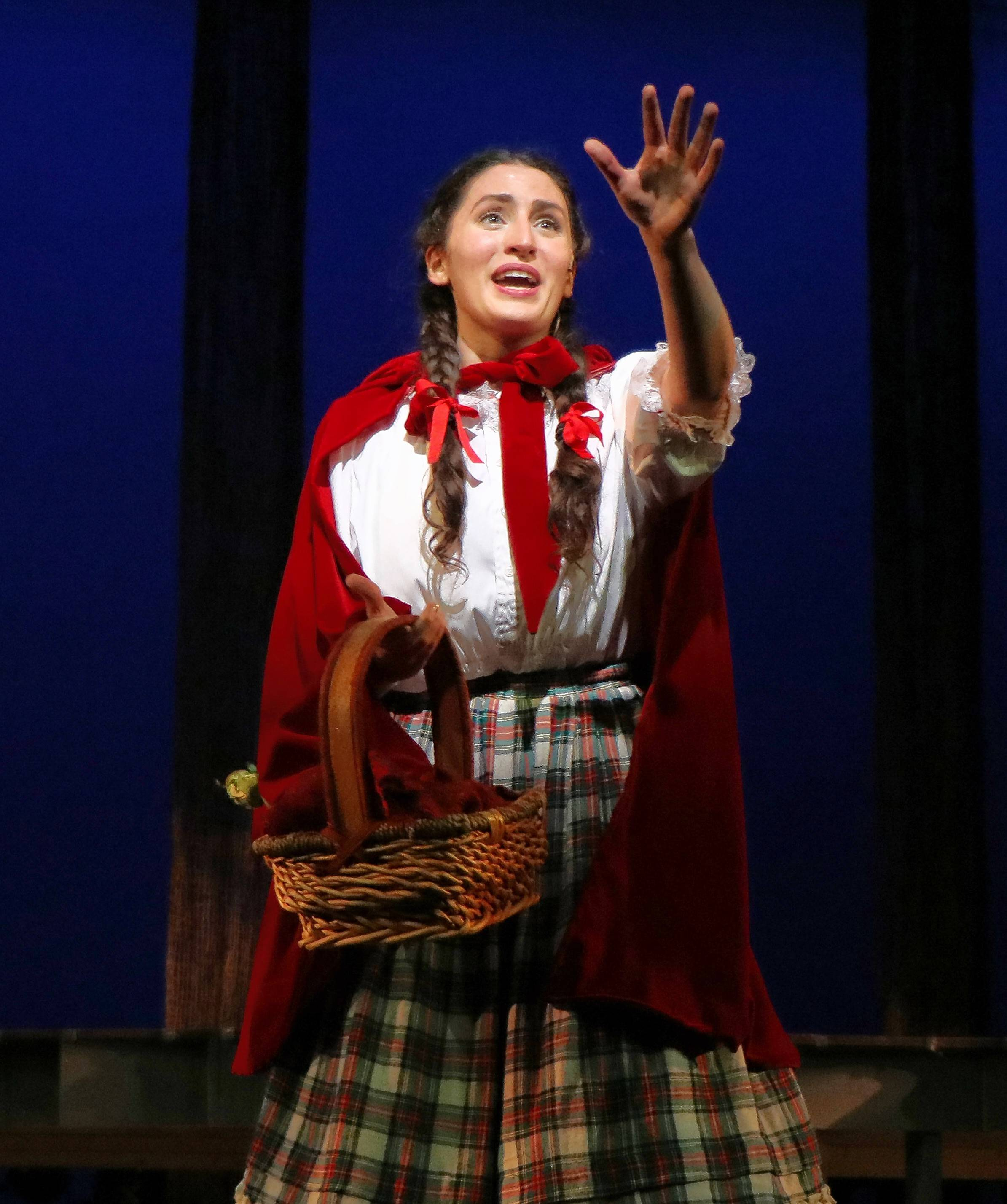 "Anna Segatti plays the spunky Little Red Riding Hood in Metropolis Performing Arts Centre's revival of ""Into the Woods,"" directed by Robin M. Hughes."