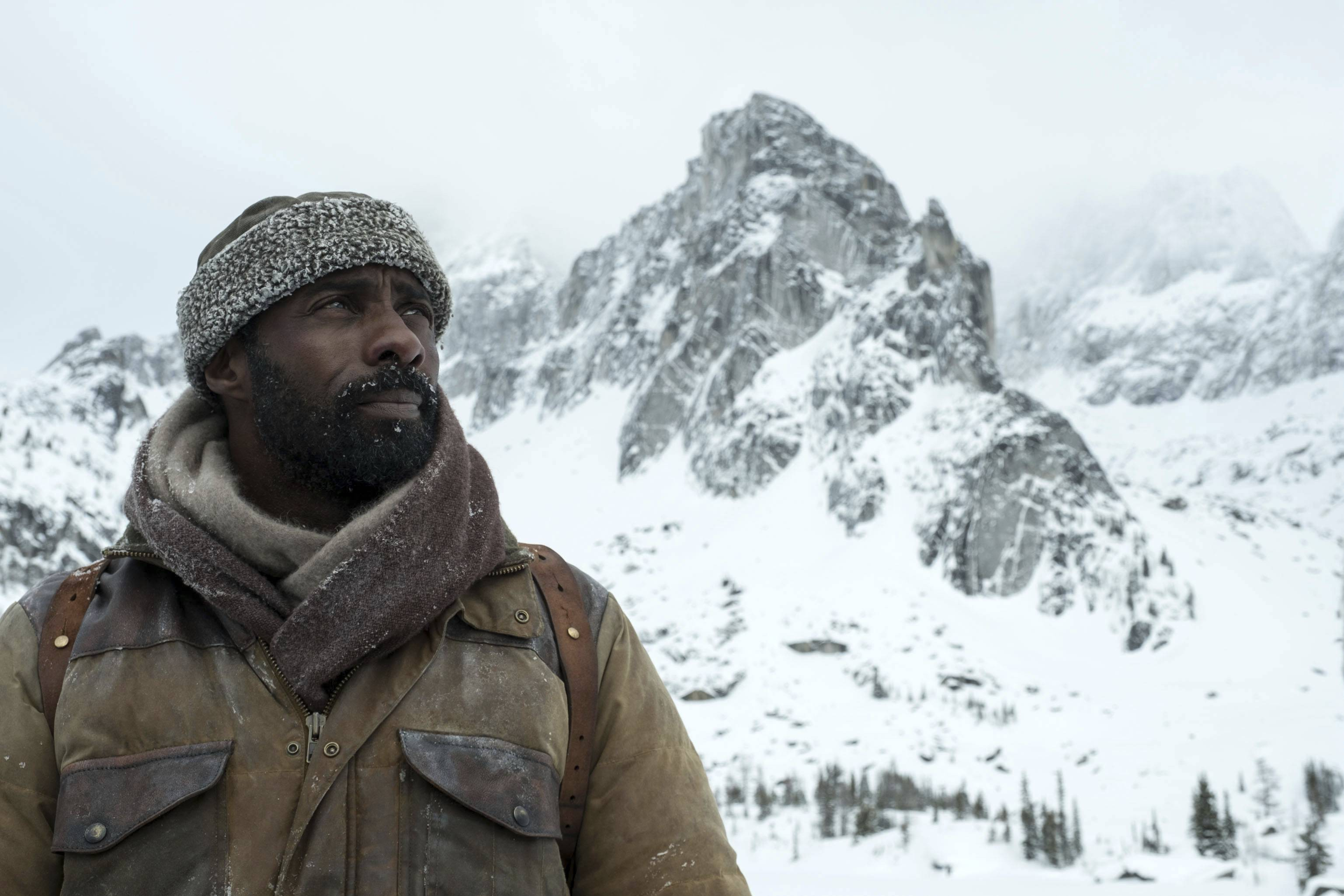 "A neurosurgeon (Idris Elba) must battle the elements and, initially, his more impulsive companion in the survival drama ""The Mountain Between Us."""