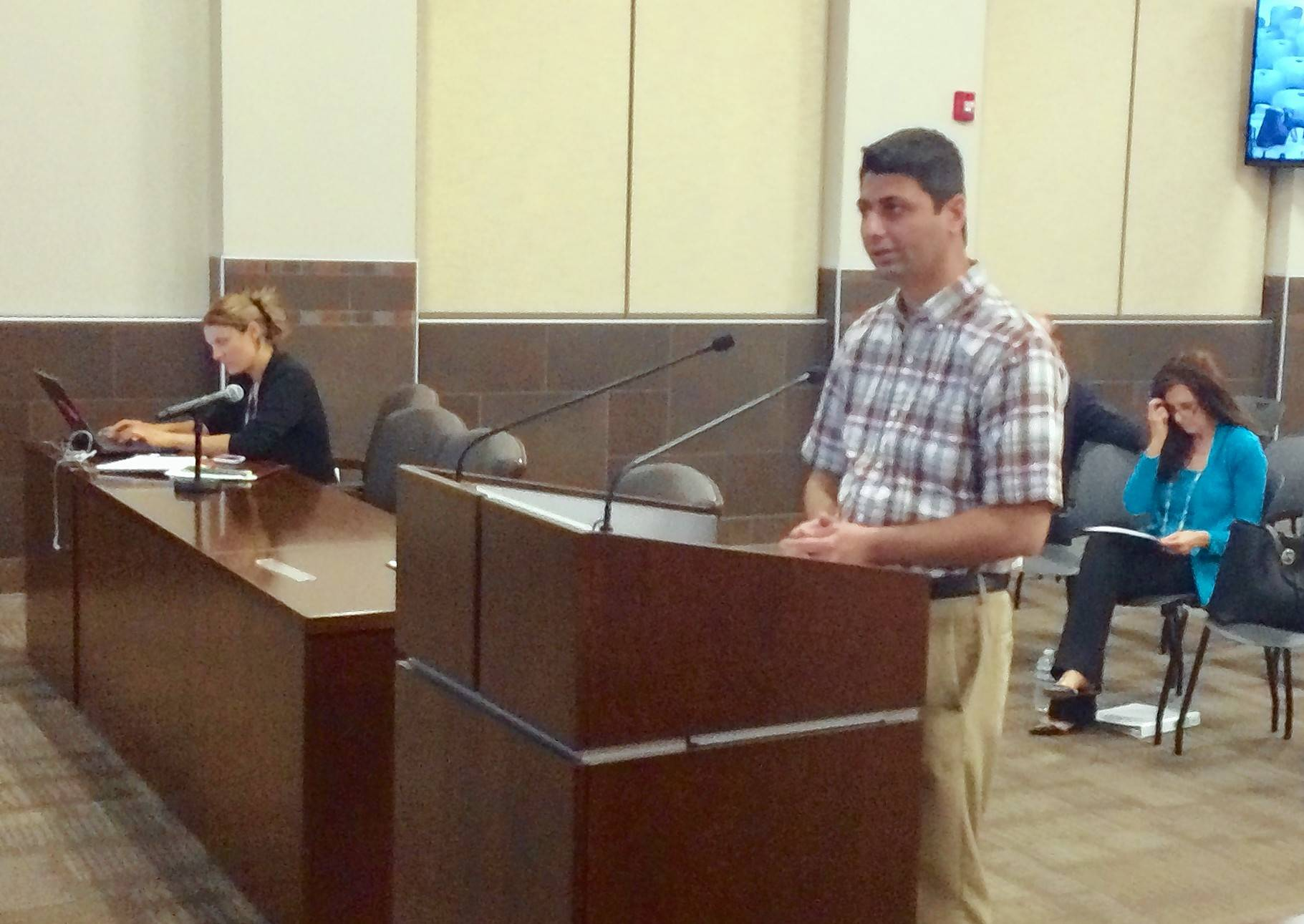Dr. Sourabh Dhawan answers questions at a Palatine plan commission meeting this week about an animal hospital proposed for the Quentin Corners plaza.
