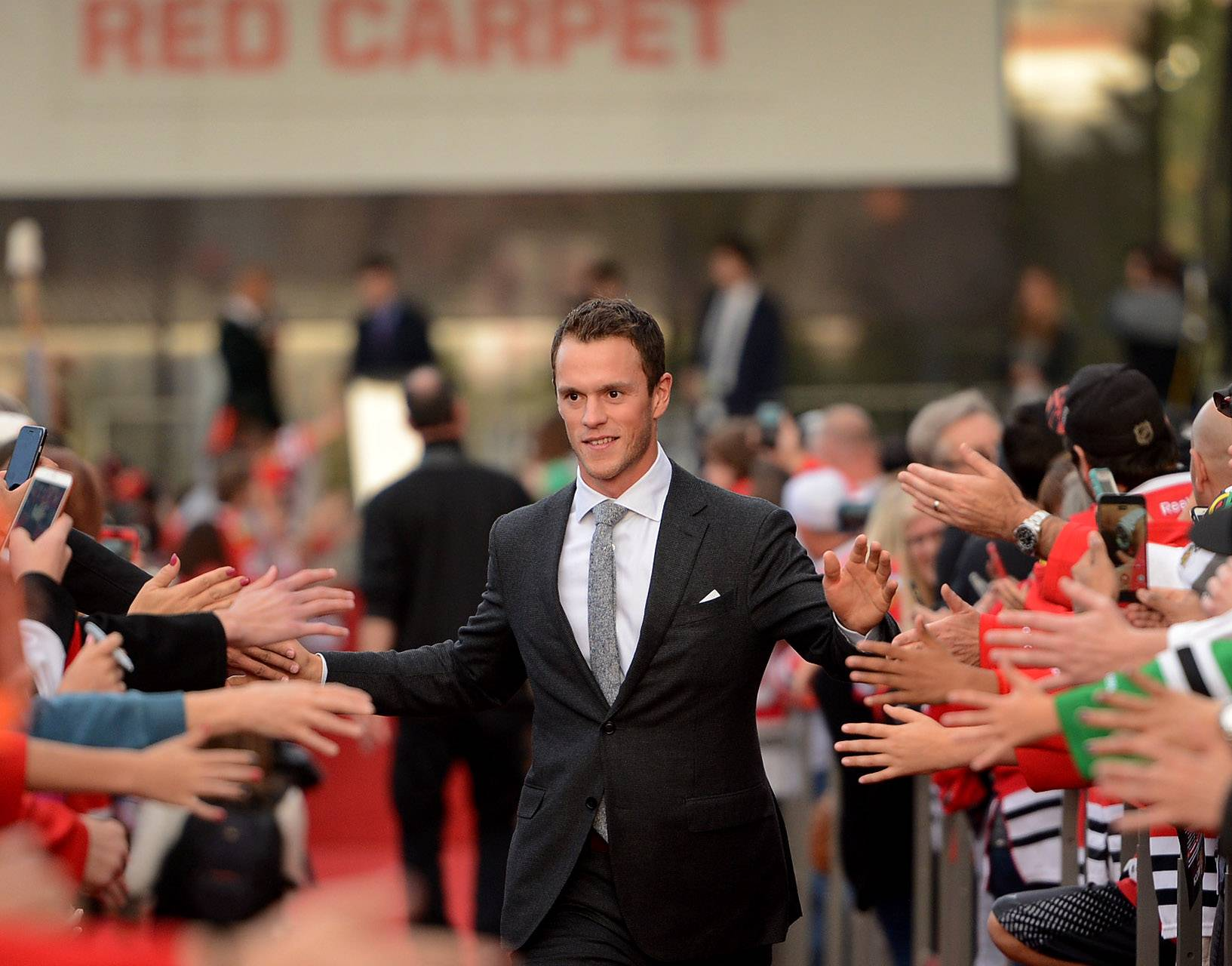 Bob Chwedyk/bchwedyk@dailyherald.comChicago Blackhawks center Jonathan Toews walks the red carpet ceremony before the Blackhawks home opener against the Penguins.