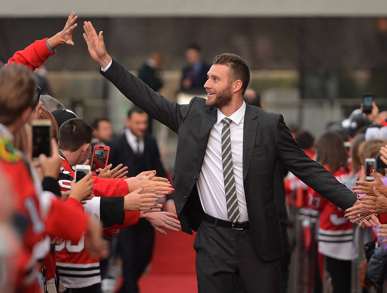 Bob Chwedyk/bchwedyk@dailyherald.comNewly acquired Chicago Blackhawks defenseman Cody Franson high-fives during the red carpet ceremony before the Blackhawks home opener against the Penguins.
