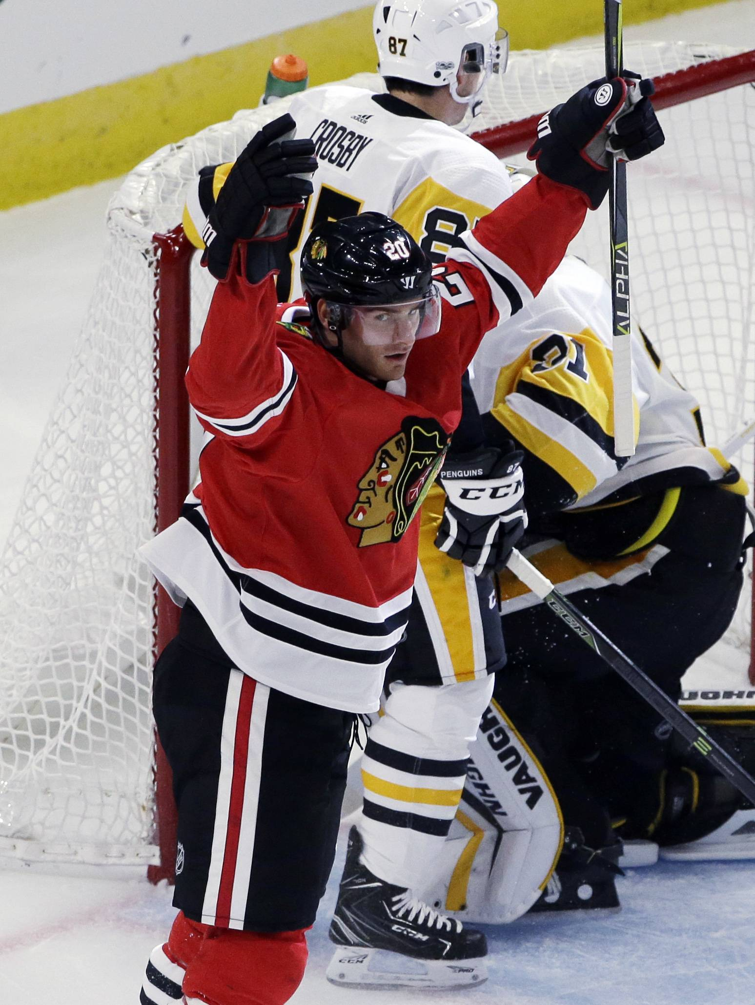 Chicago Blackhawks left wing Brandon Saad celebrates after scoring his first goal during the first period of an NHL hockey game against the Pittsburgh Penguins, Thursday, Oct. 5, 2017, in Chicago.
