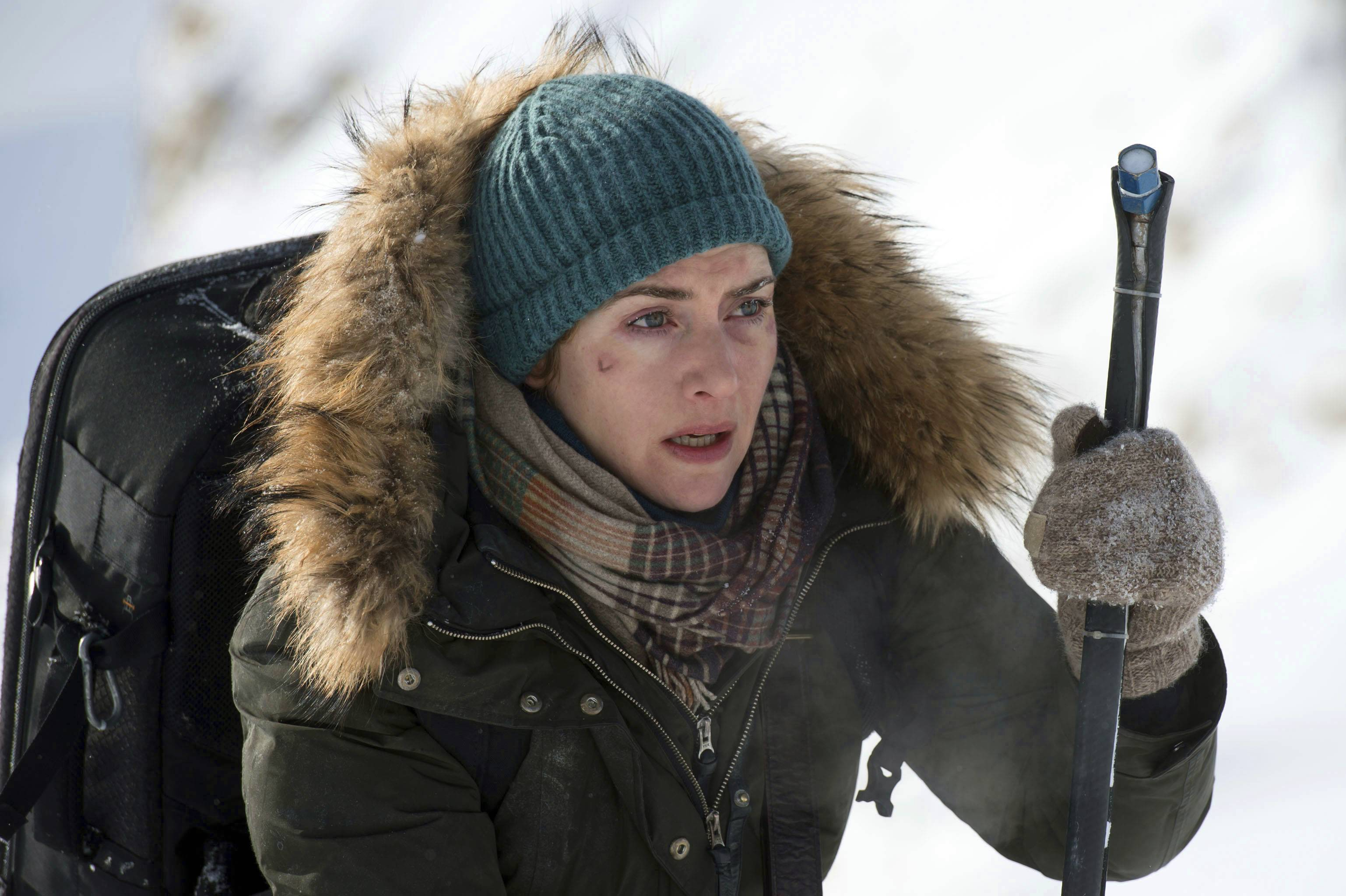 "A photojournalist (Kate Winslet) is drawn to a fellow plane crash survivor in ""The Mountain Between Us."""