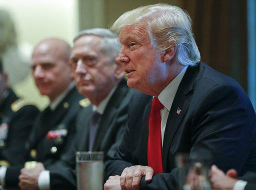 President Donald Trump, right, speaks during a briefing with senior military leaders in the Cabinet Room of the White House in Washington, Thursday, Oct. 5, 2017, with National Security Adviser H.R. McMaster, left, and Defense Secretary Jim Mattis, center.