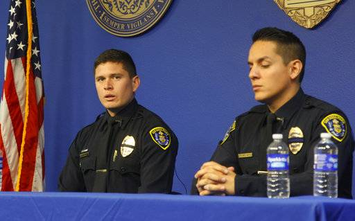 FILE - In this Wednesday, Oct. 4, 2017, file photo, San Diego Police officers Tom McGrath, left, and Max Verduzco, speak with the news media about their experience at Sunday's Las Vegas shooting, in San Diego, Calif. Both officers were off duty at the time and attending the concert with family and friends when they found themselves in situation where they aided wounded and helped other flee from the area. The Sunday night crowd of about 20,000 country music fans happened to include many off-duty police and firefighters, who sprang into the role of first responders when tragedy struck and played an important role in saving lives. (Nelvin C. Cepeda/The San Diego Union-Tribune via AP)