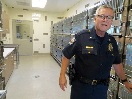 FILE - In this June 20, 2017, file photo, Seguin, Tex., Deputy Police Chief Bruce Ure shows off a cat room at the city's new animal shelter in San Antonio, Texas. Ure was off duty and attending the music festival in Las Vegas when a gunman opened fire on Sunday, Oct. 1, 2017. The Sunday night crowd of 20,000 country music fans happened to include many off-duty police and firefighters, who sprang into the role of first responders when tragedy struck and played an important role in saving lives. (Zeke MacCormack/The San Antonio Express-News via AP, File)
