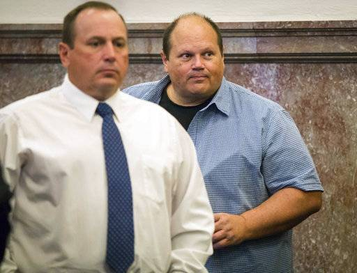 File - In this June 29, 2017 file photo, Tommy Tipton, left, and his brother Eddie Tipton, appear at the Polk County Courthouse in Des Moines, Iowa. The brothers have recently been sentenced for conspiring to use Eddie Tipton's job at the Multi-State Lottery Association to fix lottery drawings in several states between 2005 and 2011. A Colorado man who split a $4.8 million lottery jackpot in 2005 has filed a lawsuit alleging that his prize should be bigger because the other two winners have been linked to the brothers' conspiracy..(Rodney White/The Des Moines Register via AP File)