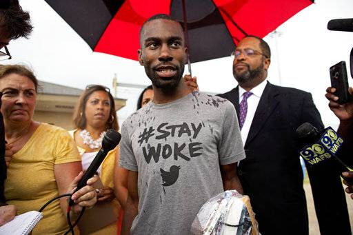 FILE - In this July 10, 2016, file photo, Black Lives Matter activist DeRay Mckesson talks to the media after his release from the Baton Rouge jail in Baton Rouge, La. U.S. District Judge Brian Jackson said he intends to dismiss a lawsuit that accuses Black Lives Matter and several movement leaders of inciting violence that led to a gunman's deadly ambush of law enforcement officers in Baton Rouge last year. Thursday, Sept. 28, 2017, Jackson threw out a police officer's lawsuit blaming Mckesson for injuries he sustained during a protest over a deadly police shooting in Baton Rouge last year.