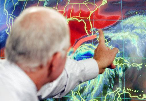 FILE - In this Oct. 19, 2005 file photo, Max Mayfield, the former director of the hurricane center (now retired), draws a line showing one of the possible trajectories of Hurricane Wilma in Miami. It's not just this year. The monster hurricanes Harvey, Irma, Maria, Jose and now Lee that have raged across the Atlantic are contributing to what appears to be the most active period for major storms on record.   AP Photo/Alan Diaz)
