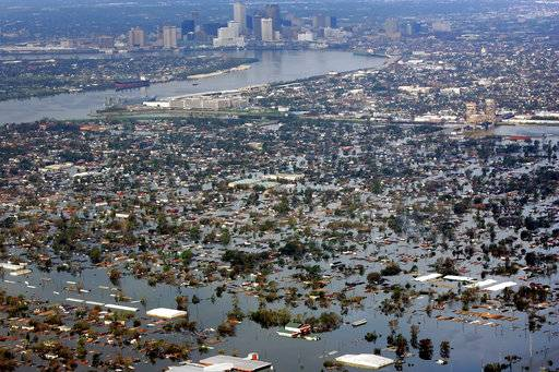 FILE - In this Aug. 30, 2005 file photo, floodwaters from Hurricane Katrina cover the lower ninth ward, foreground, and other parts of New Orleans, a day after the storm passed through the city.  It's not just this year. The monster hurricanes Harvey, Irma, Maria, Jose and now Lee that have raged across the Atlantic are contributing to what appears to be the most active period for major storms on record.