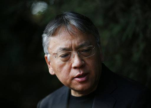 "British novelist Kazuo Ishiguro speaks during a press conference at his home in London, Thursday Oct. 5, 2017. Ishiguro, best known for ""The Remains of the Day,"" won the Nobel Literature Prize on Thursday, marking a return to traditional literature following two years of unconventional choices by the Swedish Academy for the 9-million-kronor ($1.1 million) prize."