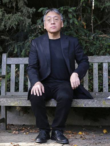 "British novelist Kazuo Ishiguro pauses during a press conference at his home in London, Thursday Oct. 5, 2017. Ishiguro, best known for ""The Remains of the Day,"" won the Nobel Literature Prize on Thursday, marking a return to traditional literature following two years of unconventional choices by the Swedish Academy for the 9-million-kronor ($1.1 million) prize."