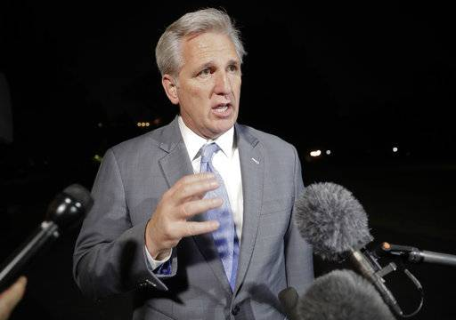 "In This Oct. 4, 2017, photo, House Majority Leader Kevin McCarthy, R-Calif., speaks to members of the media after returning to the White House in Washington with President Donald Trump from a trip to Las Vegas after the mass shooting earlier in the week. The National Rifle Association announced its support Thursday for regulating ""bump stocks,"" devices that can effectively convert semi-automatic rifles into fully automated weapons and that were apparently used in the Las Vegas massacre to lethal effect."
