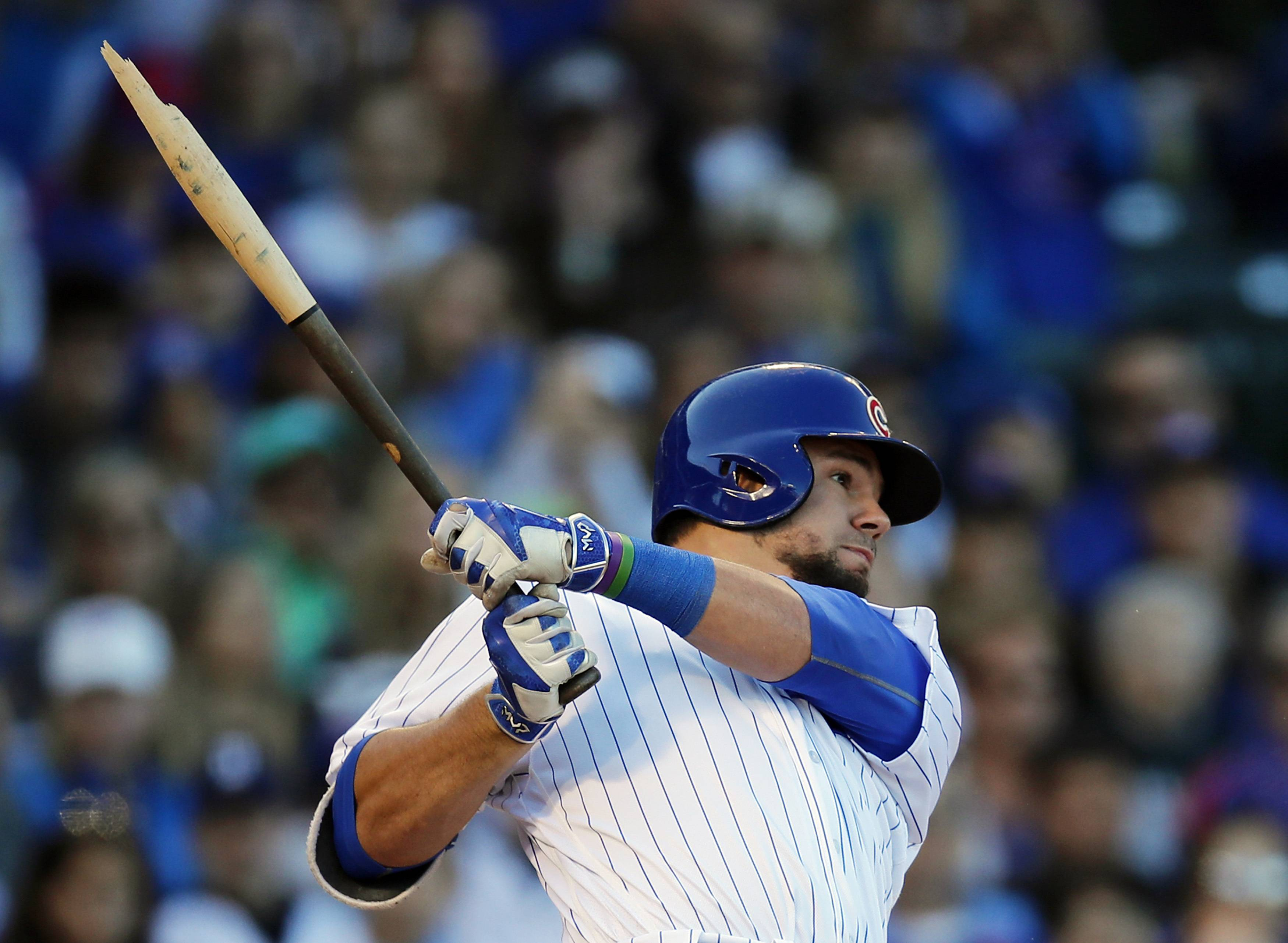 Chicago Cubs' Kyle Schwarber breaks his bat on a two-run single against the Cincinnati Reds during the third inning of a baseball game Saturday, Sept. 30, 2017, in Chicago.