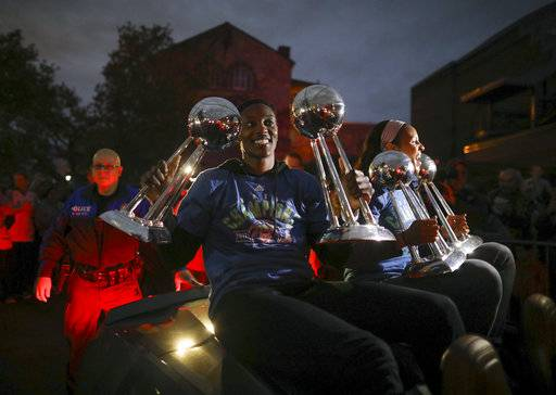 Minnesota Lynx players Sylvia Fowles, left and Maya Moore held up all four WNBA championship trophies as the team arrives at Williams Arena for a celebration Thursday night, Oct. 5, 2017, in Minneapolis. (Jeff Wheeler/Star Tribune via AP)