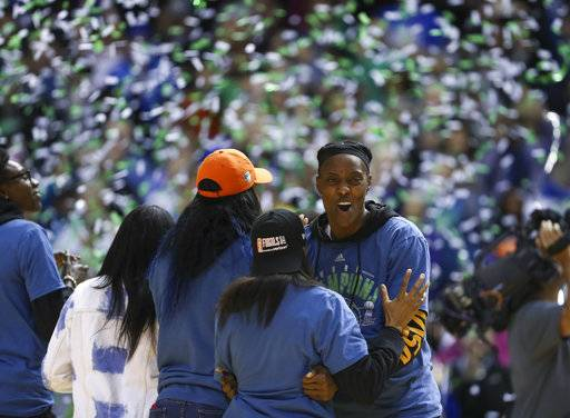 Minnesota Lynx center Sylvia Fowles, facing camera, celebrates with Lynx guard Renee Montgomery as confetti falls in the Williams Aren for the WNBA championship celebration Thursday night, Oct. 5, 2017 in Minneapolis. (Jeff Wheeler/Star Tribune via AP)