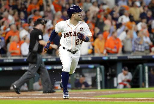 Houston Astros' Jose Altuve (27) watches his home run clear the fence during the first inning in Game 1 of baseball's American League Division Series against the Boston Red Sox, Thursday, Oct. 5, 2017, in Houston.