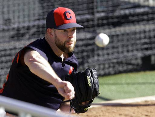 Cleveland Indians starting pitcher Corey Kluber throws during a workout, Tuesday, Oct. 3, 2017, in Cleveland. The Indians will play the winner of the wild card game between the New York Yankees and the Minnesota Twins in the ALDS on Thursday.