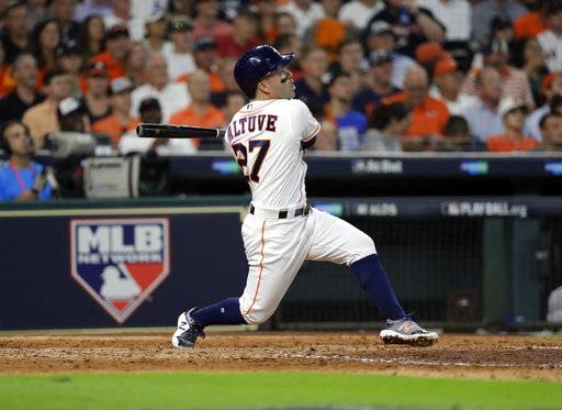Houston Astros' Jose Altuve watches his a solo home run, his third of the game, against the Boston Red Sox in the seventh inning in Game 1 of baseball's American League Division Series, Thursday, Oct. 5, 2017, in Houston.